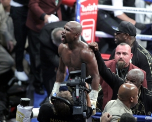Boxing: Fifty and out as Mayweather stops brave McGregor