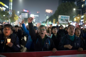 S. Korean ruling party urges Park to quit in April