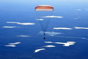 Two Russians, one American land back on Earth from ISS